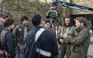 "Jiang Wen (second from right) stands with ""Rogue One: A Star Wars Story"" director Gareth Edwards (right) on set."