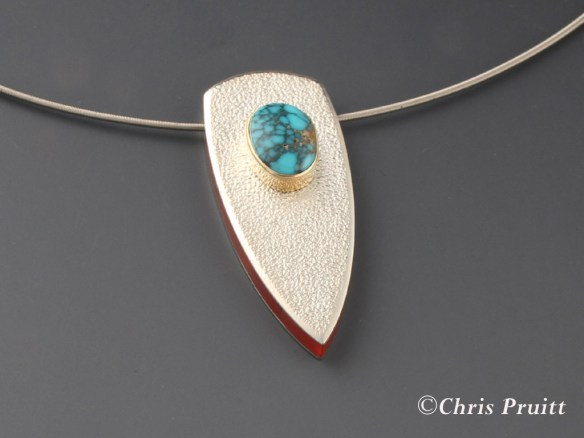 Fabricated pendent of sterling silver, 18k gold, natural Lone Mountain turquoise and channel inlayed mediterranean coral. #1