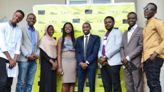 The speakers posing with guests following the Creative Architects event (from left to right): Architects Gregg Ihenyen and Hassan Anifowose, and Animator Chris Okonkwo.