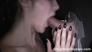 Sexy Brunette Sucks Cock in Gloryhole