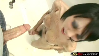 Short haired ladyboy sits on toilet and sucks big cock cum