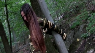 Soldier Girl Roped To Tree Camouflage Catsuit And Leather Boots