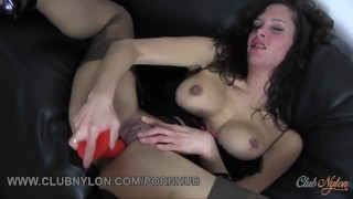 Dirty brunette slut with big boobs fucks her toy in fully fashioned nylons