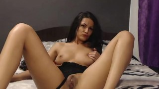 camgirl fingering her pussy and licking her fingers