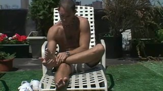 Lusty homosexual teases with feet and licks his toes