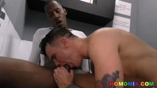 Black men sharing a whiteboi at a gloryhole