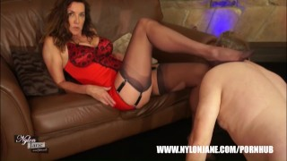 Milf Nylon Jane teases guy with nylon covered feet rubbing his face cock