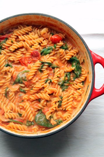 one pot pasta has a luxurious tomato and mascarpone sauce, spinach ...