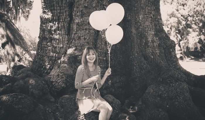 Ciera Sitting On Oak Tree With Balloons