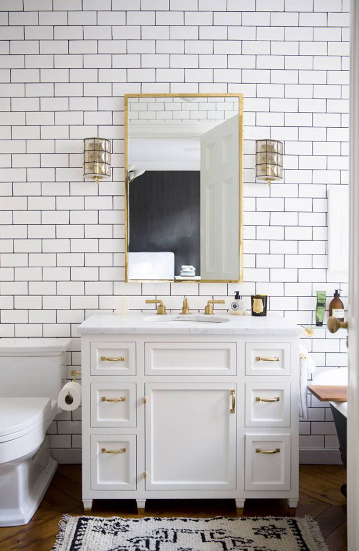 White and Gold Subway Tile Bathroom
