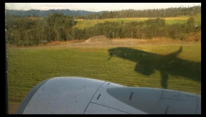 jet plane shadow, taking off from Bergen