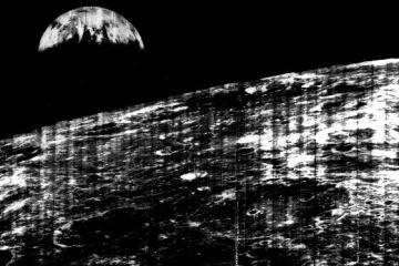 Lunar Orbiter photographed the earth for the first time (23th of august 1966). Taken with a Xenotar 2,8 / 80 mm.