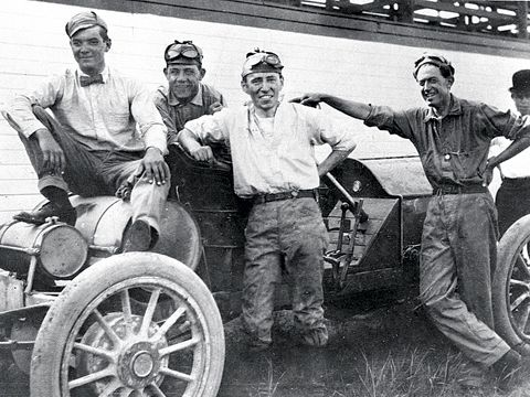 Louis Schwitzer (second from right) pictured with the car he drove to victory in the first race ever held at the Indianapolis Motor Speedway.