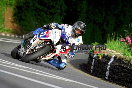 Crowd favorite Guy Martin broke the old lap record but still awaits that elusive win  on the Island