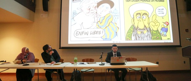 A video about the Charlie Hebdo controversy preceded the panel speakers. (Photo: Chris Juhn/City College News)