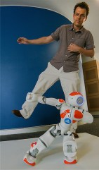 "University of Canberra associate professor Roland Goecke and robot ""Ardie"" practise tai chi. Photos by Gary Schafer"