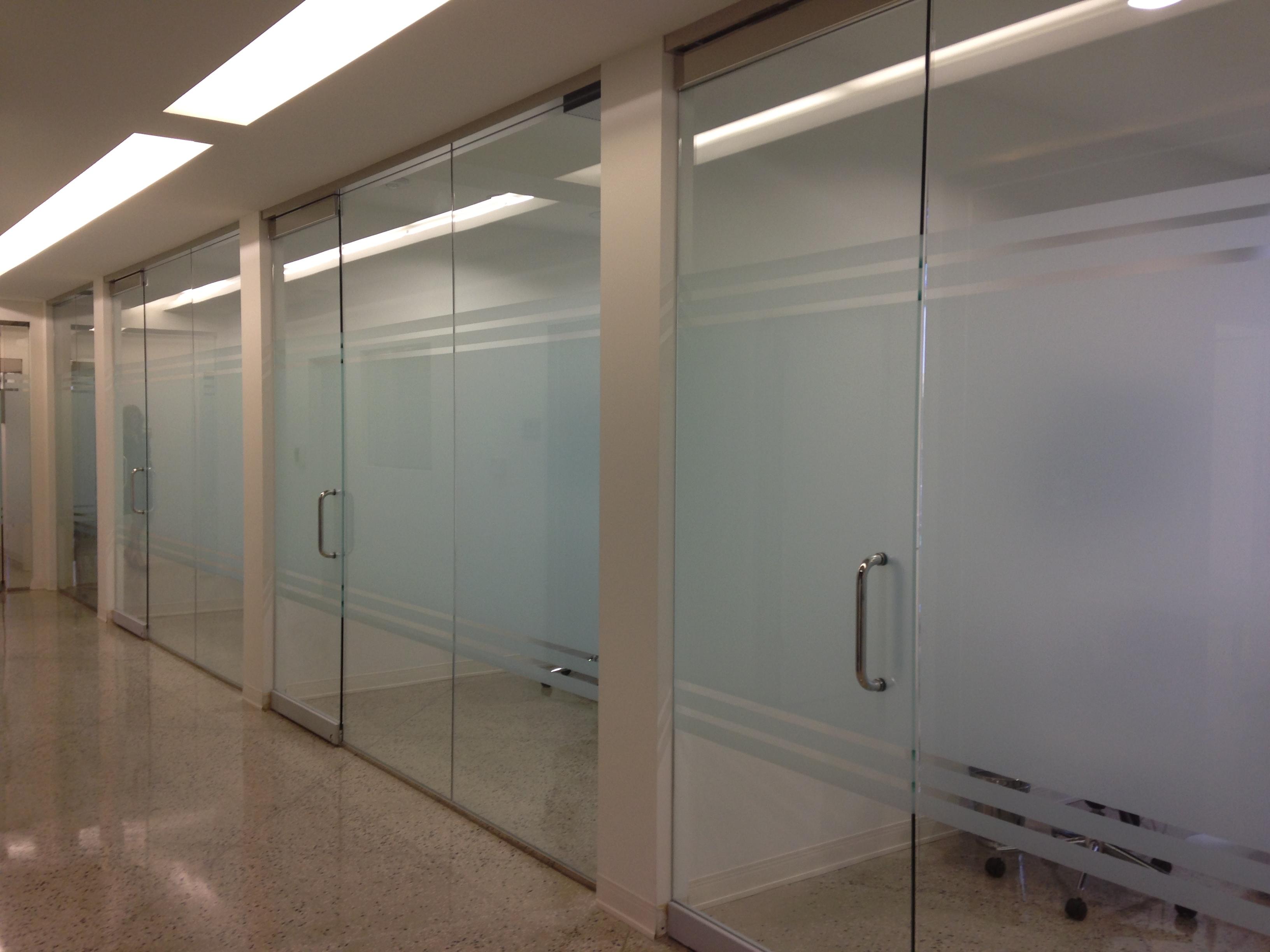 Decorative window film install in dental office Dallas, Tx