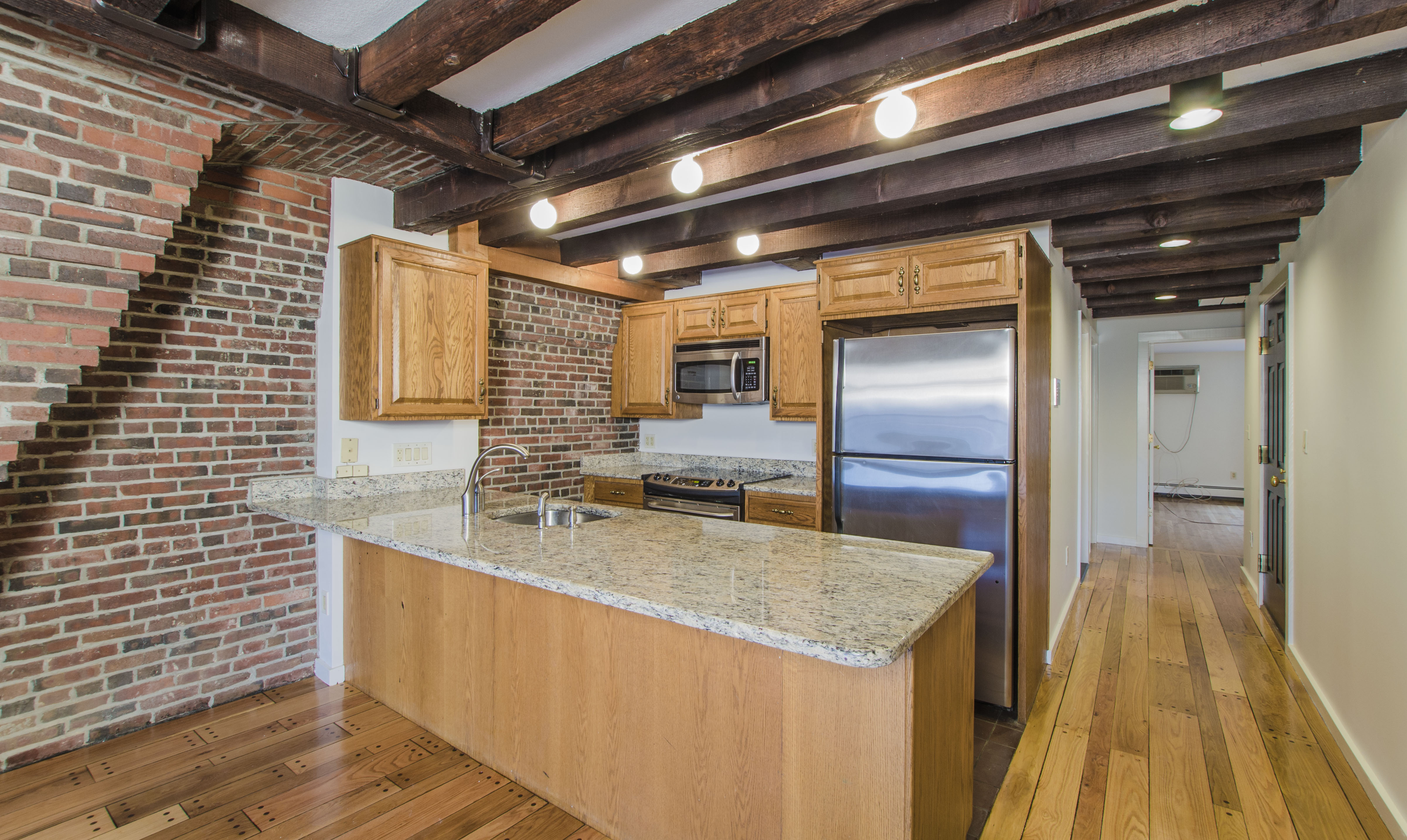Apartments With Exposed Brick Exposed Brick And Beams Two Bedroom City Suites
