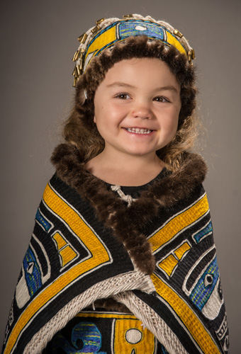 "Clarissa's grand-daughter, Amelie models ""Chilkat Child"" to be featured as 1 of 18 Chilkat robes to be exhibited during the Antique Native American Art Show"