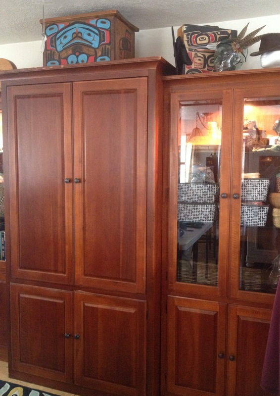 10' wide x 7' high, beautiful, functional cherry wood entertainment center converted into a storage unit