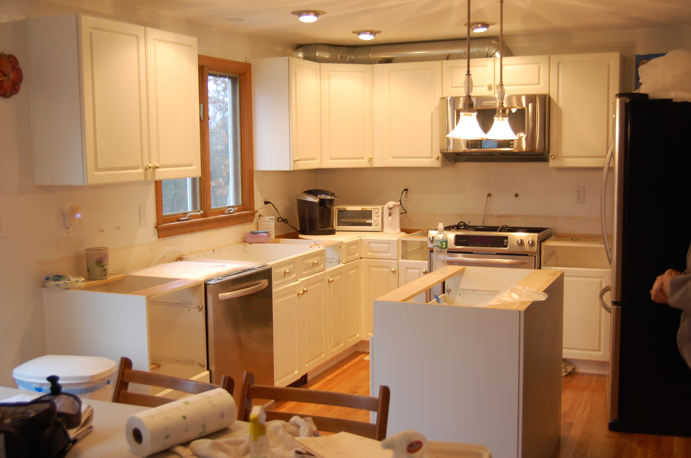 More Before and After Cabinet Refacing Photos 3 refacing kitchen cabinets A Classic KKitchen photo of a kitchen before refacing
