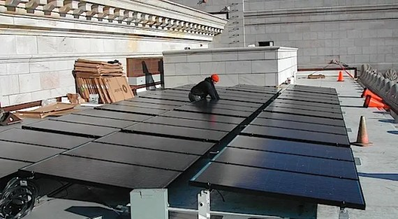 Installing PV panels on the Washington State Legislature – Photo Courtesy TASC