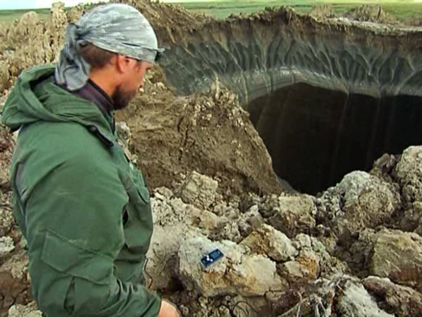 A researcher examines the hole