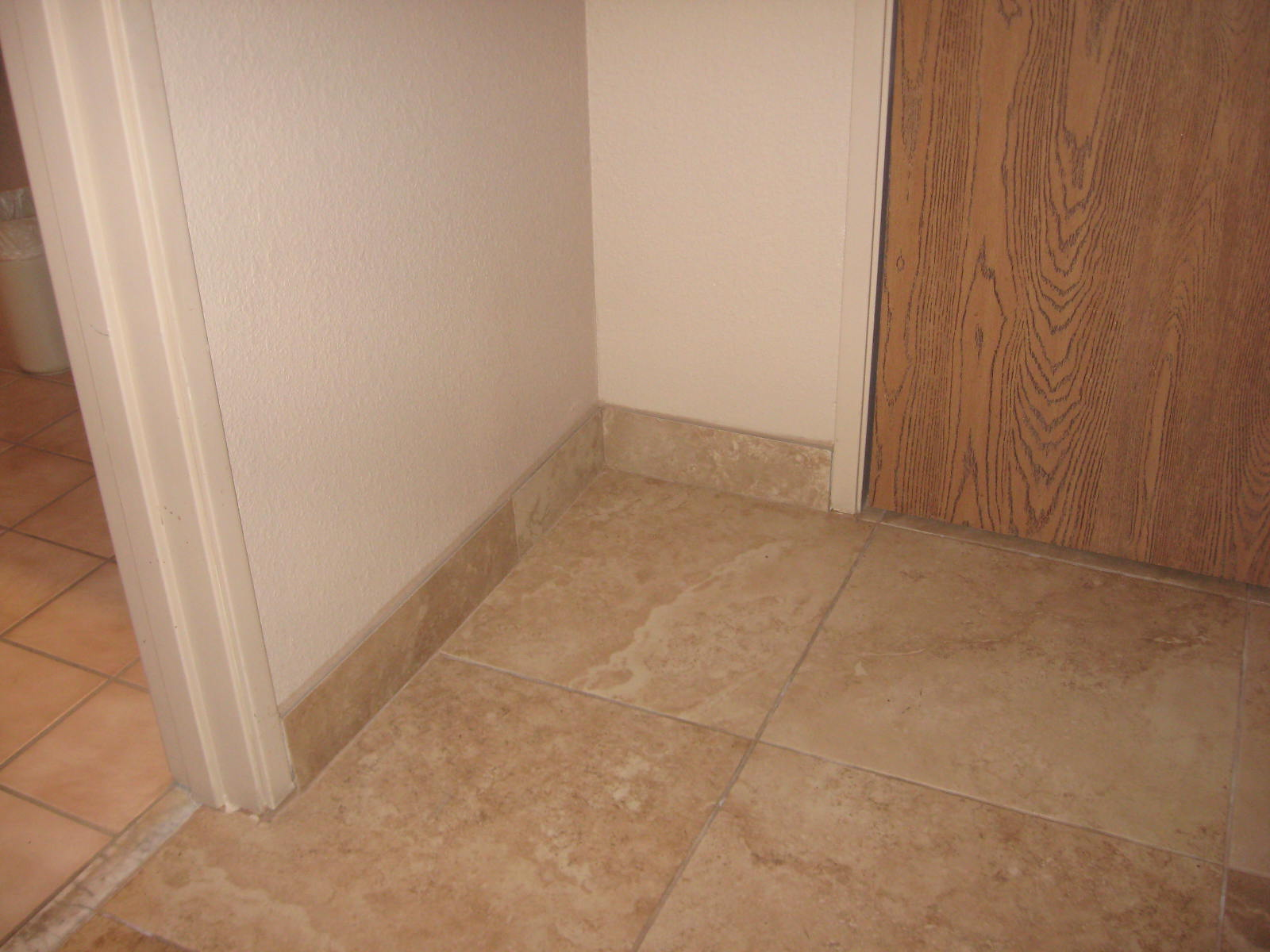 Tile floor baseboard trim image collections tile flooring design caulk baseboard to tile floor choice image home flooring design tile floor baseboard trim gallery tile doublecrazyfo Image collections