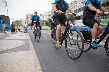 Bikers ride along Copacabana Beach in Rio de Janeiro, Brazil on Aug. 8, 2016.