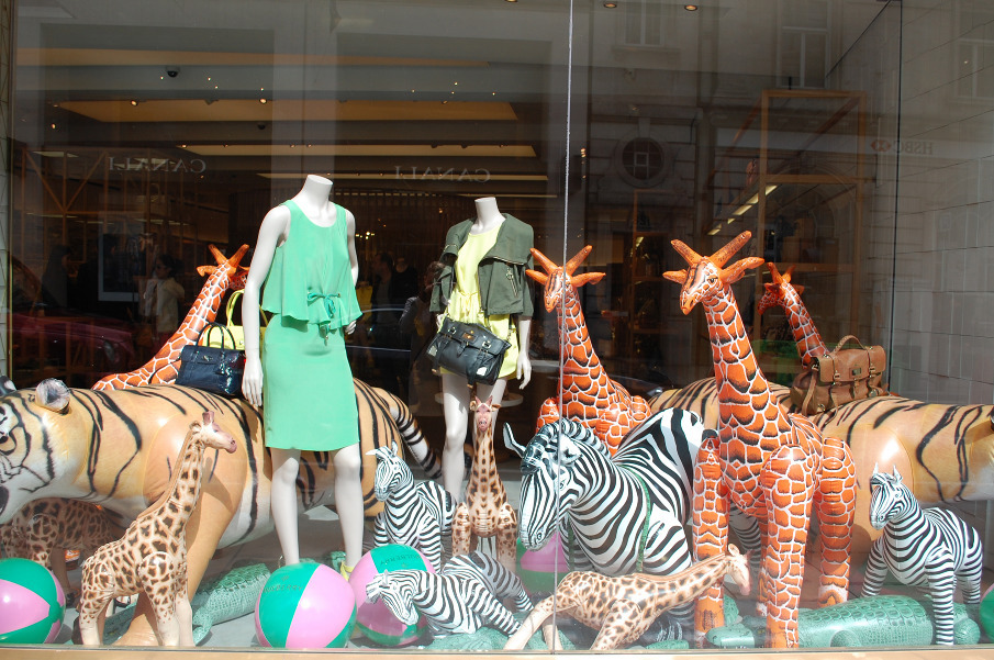 Retail window display with inflattable animals resembles scene from best music festivals in the world
