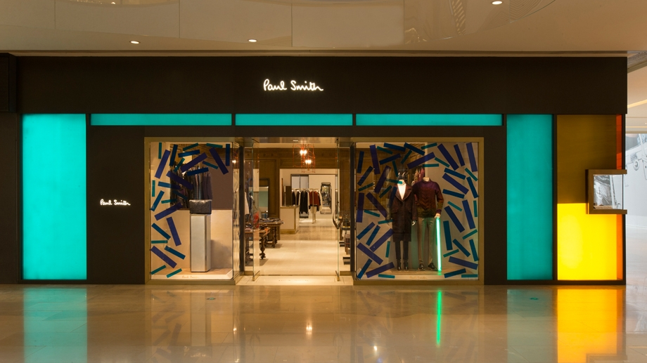 Bronze Window Display Contrasts with Pastel Lightbox Walls to Show Products