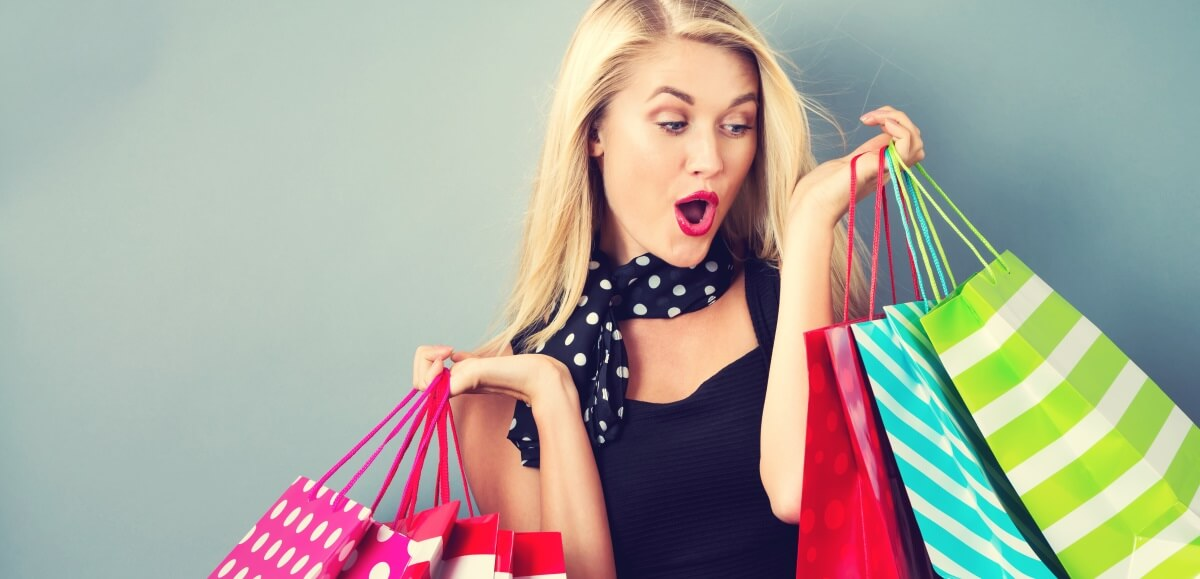 woman looking excited over her shopping bags