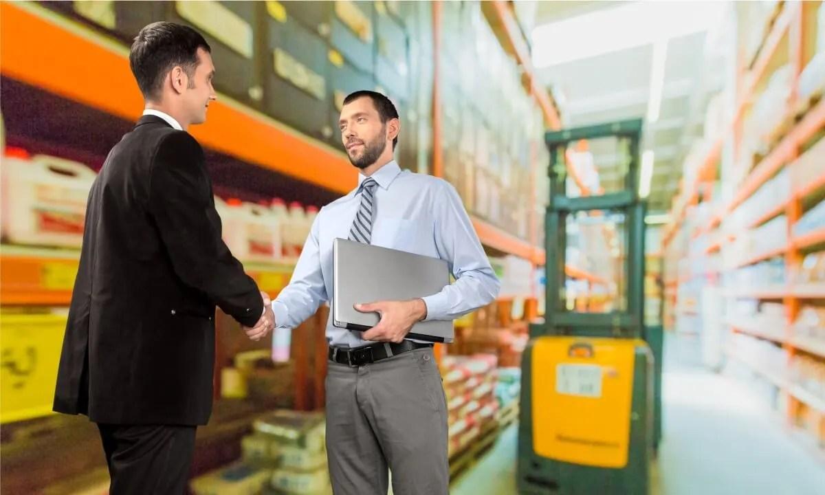 two men shaking hands in ttorehouse