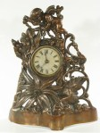 Golden Novelty Company Cast Front Clock, 1885 Patent, Cherub and Flowers