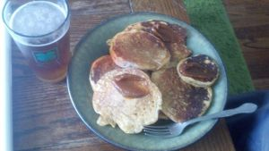 Post-run pancakes, pumpkin butter, maple syrup, and beer.