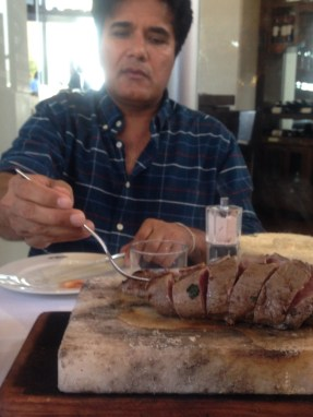 Hayden Nasir of Evolution Salt enjoying steak seared on a salt block in Monterrey Mexico.  Evolution Salt is opening a housewares packaging and distribution facility in Monterrey in Q2 2016.