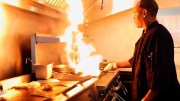 Chef Wayne Hall blazes up the grill in the kitchen of The Backyard Restaurant.