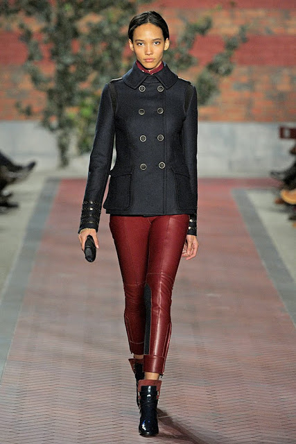 model from tommy hilfiger's fall 2012 runway show wearing oxblood leather pants and navy pea coat