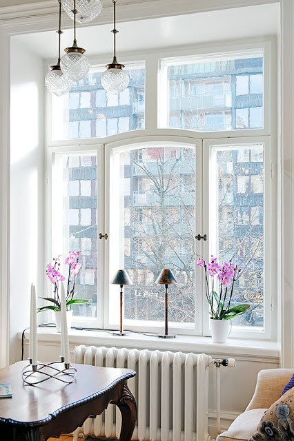 Large window with view in bright sun lit apartment good natural light