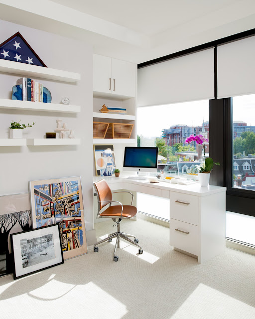 White home office with floating shelves and an amazing view of Washington, DC