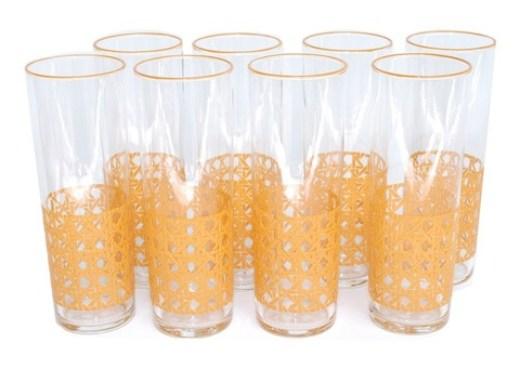 8 vintage glasses with orange cane pattern on the bottom third and orange rims