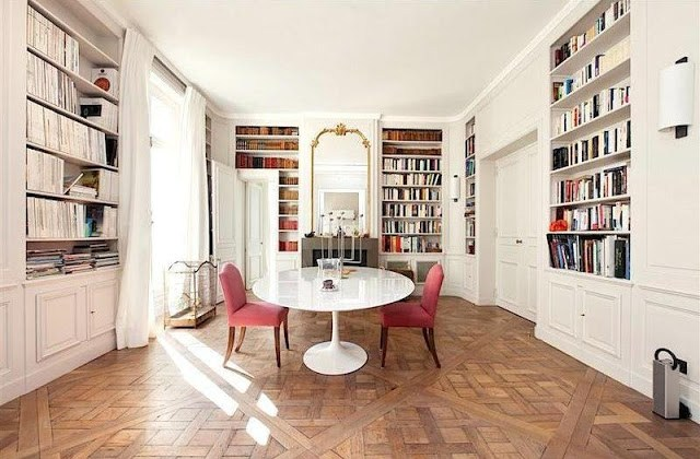 Dining room with parquet floors, built in bookcases, fireplace and high ceilings