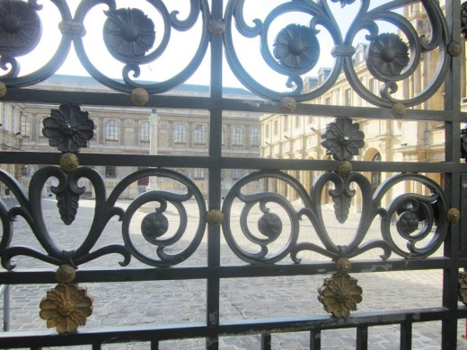 Details on the iron gate at the Palais Etudes courtyard of the Ecole des Beaux Arts in Paris