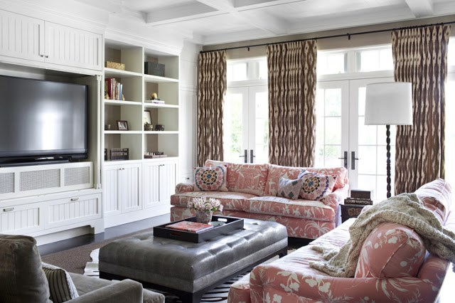 T.V. Room with Palm Beach style fabric upholstered sofas and a large leather ottoman.
