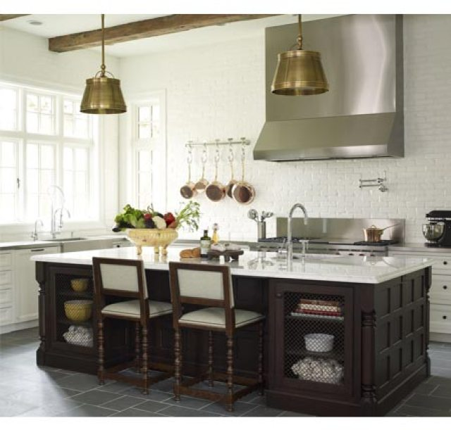 bella casa design's kitchen with brass pendant lights and a wood island with marble counter top