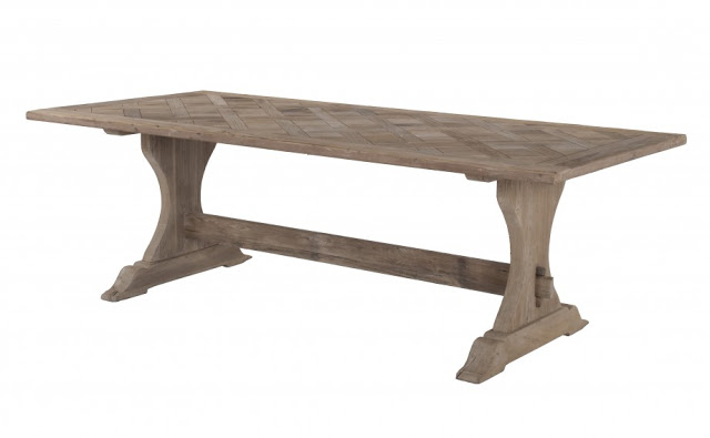 Rustic kitchen table made of reclaimed elm with a natural smoked wood finish
