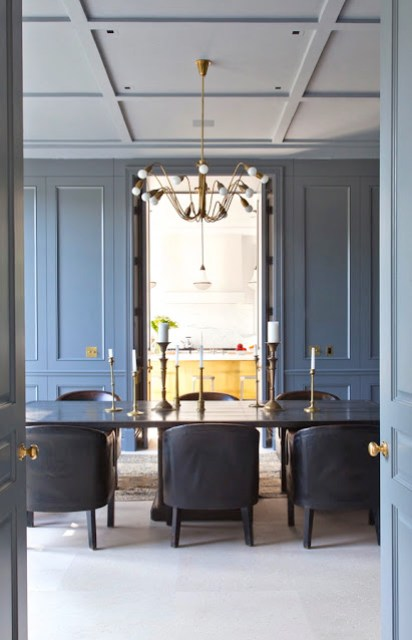 alternative view of a formal dining room with steel painted paneled walls, white coffered ceilings and brass accents