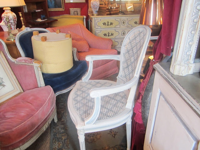Coco's Paris flea market find: a set of four grey painted trellis pattern on a white cane back armchairs