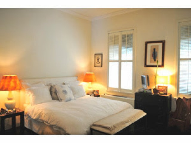 Rebecca de Ravenel's plain white bedroom before being redecorated