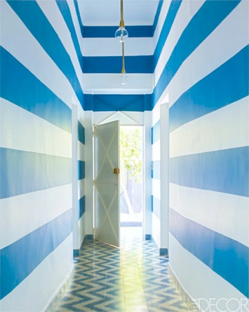 foyer entryway chevron cement tile floor stripe wall blue white brass ceiling light front door